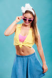 Portrait of happy pin up girl wearing sunglasses. Royalty Free Stock Photography