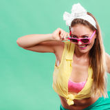 Portrait of happy pin up girl wearing sunglasses. Stock Image