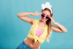 Portrait of happy pin up girl wearing sunglasses. Stock Images