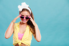 Portrait of happy pin up girl wearing sunglasses. Stock Photography