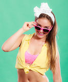 Portrait of happy pin up girl wearing sunglasses. Stock Photo