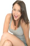 Portrait of a Happy Pleased Relaxed Young Woman Smiling Looking Pleased Royalty Free Stock Images