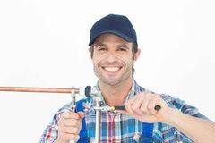Portrait of happy plumber fixing pipe Royalty Free Stock Photography
