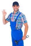 Portrait of happy plumber with plunger gesturing okay Royalty Free Stock Images