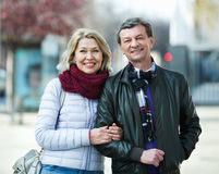 Portrait of happy positive mature couple in city Stock Image