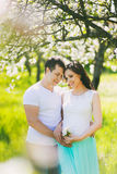 Portrait of happy pregnant family Stock Photography