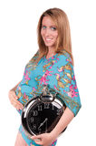 Portrait of happy pregnant woman with clock Royalty Free Stock Photography