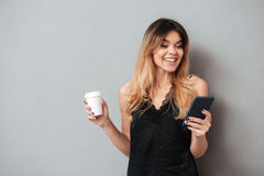 Portrait of a happy pretty girl holding coffee cup stock images