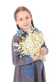 Portrait of a happy pretty girl holds a flower of a lily of the valley. royalty free stock photo