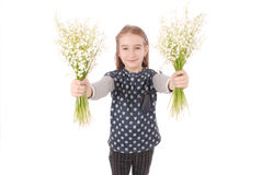 Portrait of a happy pretty girl holds a flower of a lily of the valley. Royalty Free Stock Photos