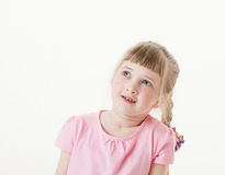 Portrait of a happy  pretty little girl looking up Royalty Free Stock Photo