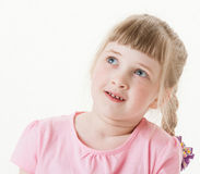 Portrait of a happy  pretty little girl looking up Stock Images