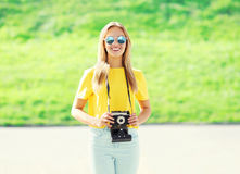 Portrait happy pretty smiling woman wearing sunglasses with camera Royalty Free Stock Photos