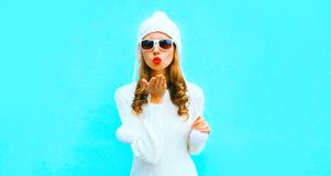 Portrait happy pretty young woman blowing red lips sends air kiss stock images
