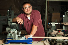 Portrait of happy professional carpenter. Royalty Free Stock Images