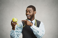 Portrait happy professional man pointing, holding green apple Royalty Free Stock Photos