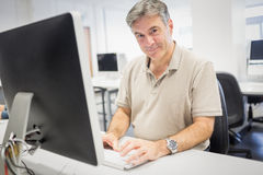 Portrait of happy professor working on computer royalty free stock photos