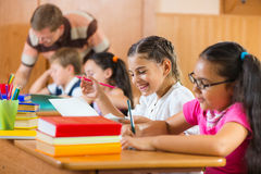 Portrait of happy pupil at lesson Stock Image