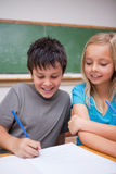 Portrait of happy pupils working together Stock Images