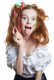 Portrait of happy red-haired girl with a brush in his hand. Human emotions. Positive. Stock Images