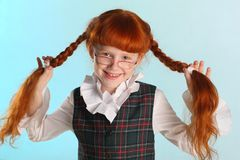 Portrait of happy redhead little schoolgirl with glasses royalty free stock photography