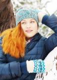 Portrait of happy redhead pretty girl in winter Stock Photography