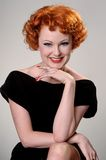 Retro portrait of vintage beauty. Portrait of happy redhead in vintage forties dress Stock Photography
