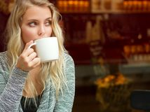 Relaxed blond having coffee. Stock Photo