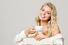 Relaxed blond having coffee. Royalty Free Stock Photo