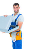 Portrait of happy repairman opening toolbox Stock Images