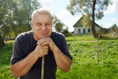 Portrait of happy rural elderly man with gray hair. Royalty Free Stock Photography
