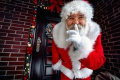Portrait of Happy Santa Claus with finger on lips royalty free stock images