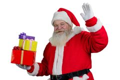 Portrait of happy Santa Claus with gifts. Stock Image