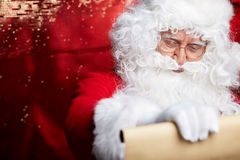 Portrait of happy Santa Claus holding Christmas letter Stock Photo