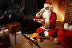 Portrait of happy Santa Claus sitting at his room at home Royalty Free Stock Images
