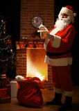 Portrait of happy Santa Claus standing at his room at home Stock Photography