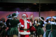 Portrait of happy Santa Girls and Santa Royalty Free Stock Photos