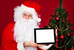 Portrait of a happy santa holding digital tablet Royalty Free Stock Photography