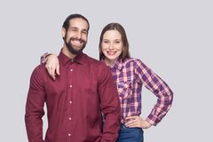 Portrait of happy satisfied bearded man and woman in casual style standing and looking at camera with toothy smile royalty free stock image