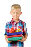 Portrait of happy schoolboy with books and apple isolated on white background. Education Royalty Free Stock Image