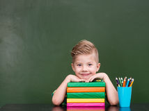 Portrait of a happy schoolboy in classroom.  Stock Image