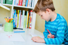 Portrait of happy schoolboy at home Royalty Free Stock Images
