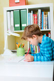 Portrait of happy schoolboy at home Stock Photography