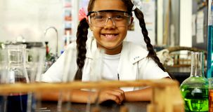 Portrait of happy schoolkid wearing protective eyewear 4k stock footage