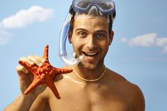 Portrait of happy scuba diver with starfish Stock Images