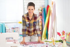 Portrait of happy seamstress in studio Royalty Free Stock Photo