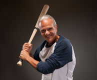 Portrait of a happy senior adult man with a baseball bat Royalty Free Stock Photography