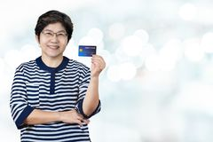 Portrait of happy senior asian woman hold credit card and showing on hand stock photos