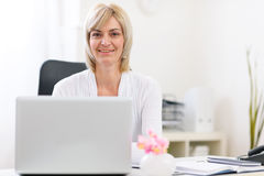 Portrait of happy senior business woman at office Royalty Free Stock Image