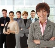 Portrait of happy senior businesswoman and team Royalty Free Stock Image